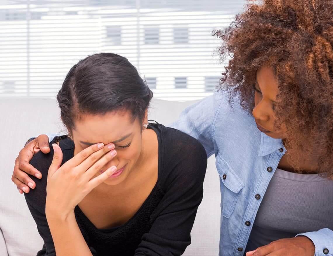 woman comforting her bestfriend